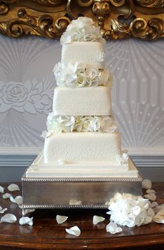 Square cake - this one is all white and therefore classic for a wedding but its square shape gives it a modern twist.