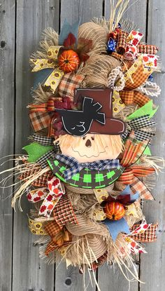 A personal favorite from my Etsy shop https://www.etsy.com/listing/551560623/scarecrow-wreath-scarecrow-swag-fall