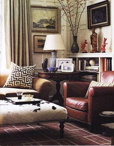 WSH <3 the hide ottoman in this traditional livingroom. Via give it a whirl.