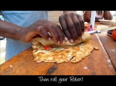 How to make a Rolex - Street Food in Uganda How to make an African style Rolex snack; a Ugandan street food with a chapati, onions, peppers and egg - and very tasty! The Rolex is a type of food eaten on the… Chapati Recipes, Ugandan Food, Breakfast Wraps, Good Food, Yummy Food, Food Science, International Recipes, Gourmet, Treats
