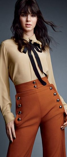 Who made  Kendall Jenner's tan tie top and brown button pants?