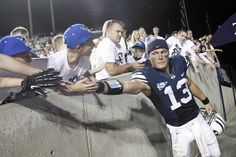 BYU quarterback Riley Nelson greets fans after the game against Washington State in Provo on Aug. 30.