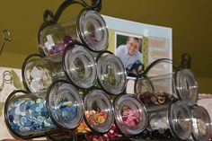 Organizational Tip: Sort & Store by Color...Wine Rack Button Storage using candle jars. More photos of brads, florals, ribbon, & chipboard alphas.