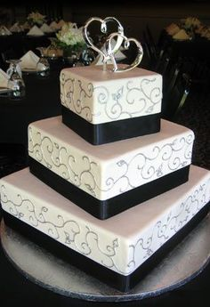 Red velvet with buttercream fondant, and a lacy patterned ribbon instead of flat black?
