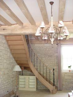 Gamme prestige : Escalier en chêne débillardé avec poteau de départ et balustres en fer