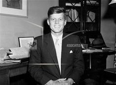 U.S. Representative John F. Kennedy running for the U.S. Senate seat from Mass.is seated at his desk in his Boston office on October 28, 1952. (AP Photo)