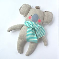 Koala toy, baby toy Koala made of linen fabric by my unique sewing pattern. Plush Koala does not have any sharp, hard, small or plastic details sewn on - suitable for babies and kids. Cute linen Koala is great gift for birthday, baby shower day or for any occasion. koala wears striped turquoise/white scarf. For other colour scarf please contact me Height approx. 30 cm (12 inch) Made in clean, smoke and pet free studio.   Hand wash in cold water, do not soak, delicate squeeze  Handmade in…