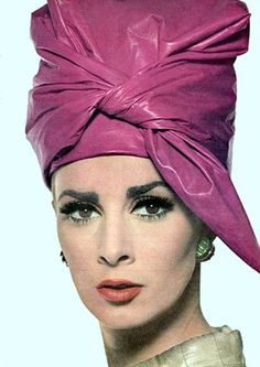 7469bc8fb034a0 Wilhelmina Cooper in a turban style magenta hat, Vogue 1964. Judith M  millinery supply