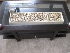 What to do with wine corks? I display mine in a wooden tray in a glass-top coffee table #diy #housedecorations #winecorks #interiordesign