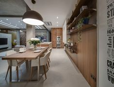 Modern Apartment Takes Openness To A Whole New Level kitchen island with seaing