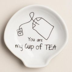 """A great gift for the tea lover and a fun accent for a tea party, our ceramic tea bag and spoon rest features the clever message, """"You are my cup of tea."""""""