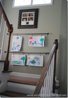 Display kids artwork on curtain or shower rods using clips for the shower curtain or drapes