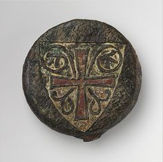 This sword pommel is decorated with the arms of Pierre de Dreux, Duke of Brittany, who was captured during the Seventh Crusade at the Battle of al-Mansurah in Egypt on February 8, 1250. He was later ransomed and released, but died during his return to France