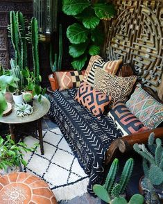 a small boho chic terrace with a printed sofa with pillows, a leather ottoman and lots of potted cacti and plants Apartment Balcony Decorating, Porch Decorating, Decorating Ideas, Apartment Plants, Porches, Bohemian Porch, Bohemian Homes, Bohemian Interior, Bohemian Decor