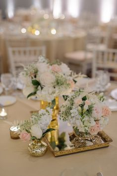 Pink and white rose centerpiece arrangements