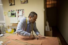 Precision: Tailor Francisco Sanchez cuts a piece of material at 'Fermin' bullfighters tailor shop