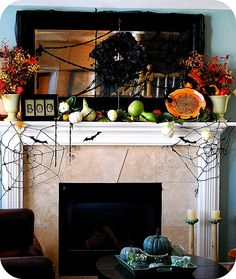 OMG this is my exact fireplace down to the tile and mirror- ok who snuck in and did the awesome decor? lol