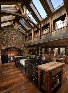 "Dream kitchen-love the skylights and the ""fireplace"" style wall, but I would probably do all the stone in brick. I love brick!"