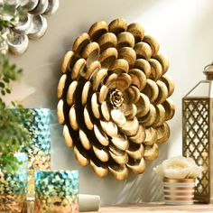 Give your home an elegant accent that sparkles and shines with our Spring Metallics Gold Flower Metal Plaque. This is not your average wall flower!