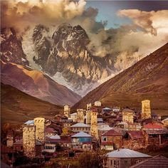 Photo by @argonautphoto (Aaron Huey). Sunset in the village of #Ushguli, #Svanetia, under Mt #Skhara, Georgia.  Because of the number of 12th-16th century defensive towers the village has been designated a UNESCO #WorldHeritageSite.  It is also the highest inhabited village in Europe. #Sakartvelo