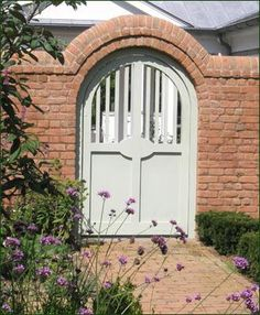 Arched Doorway Gate - Housed snugly within a bricked archway, the walk gate has square pickets on top & solid board panels beneath - Walpole Woodworkers