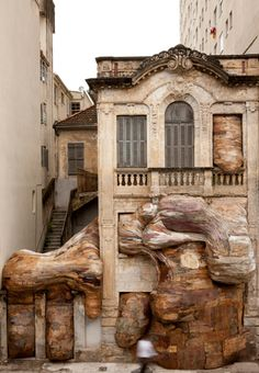 """`.""""Henrique Oliveira is a Brazilian artist known for working with salvaged wood which he peels and used to create these incredible installations. The texture of the wood is reminiscent of the strokes of a paint brush or the folds of human fat, giving some eerie, living feeling to his installations."""""""