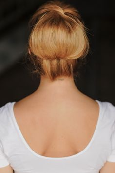 high twisted chignon tutorial - I did my hair like this at work and it has stayed ALL DAY.