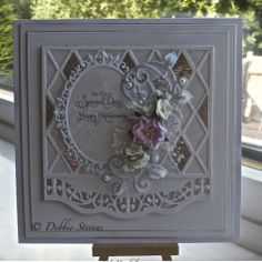 ImageSpellbinders grand squares, Spellbinders scalloped borders 2, papertrey harlequin die, joy crafts frame 6002/0258, heartfelt creations holly berry die and matching stamp, the ink ive used on the leaves is Tim Holtz peeled paint, sentiment from justrite. card stock from annamarie designs.