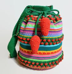 """An original creation by Ukraine-based crochet artist Veselunka, 'Strawberries Fields Forever' is a boho bag design bursting with personality and color ♥  It's hand-crocheted in a Jacquard Crochet pattern and measures an impressive 12.5"""" (32cm) in height with a 9.5"""" (25cm) diameter and 22-42"""" (56-106 cm) crossbody shoulder straps. Lightweight and breathable, the bag weighs just 550g or 19oz and can carry several items and accessories including your wallet, sunglasses, sunscreen, cell phone…"""