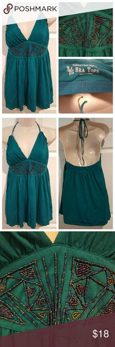 """Victoria's Secret Bra Top Pre-loved, great condition! Victoria's Secret Bra Top in beautiful emerald green color with embellished, decorative metallic beads. Low v-neck cut with tie around the neck. Built in bra lining. Extra buttons packet includes spare beads.   Measurements:  36"""" Bust  15"""" Flat Waist (empire waist)  29"""" Length  Shell: 60% Cotton, 40% Modal Bra Lining: 95% Supima Cotton, 5% Spandex Victoria's Secret Tops"""