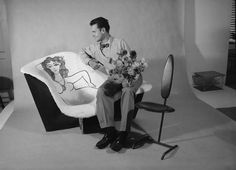 A Photo of Charles posing with a La Chaise he decorated. From a TIME Life shoot in California, 1951.
