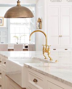 White and brass kitchen
