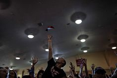 TAMPA, FLA. 11/5/2016 Trump supporters vied for the hats being tossed out at a campaign event. Damon Winter/The New York Times