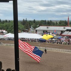 #NavySeals flying in with the American flag at #CheyenneFrontierDays - it's #Rodeo time