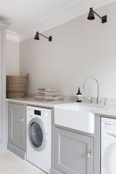 modern laundry room design with gray laundry cabinets and farmhouse sink with mo. modern laundry room design with gray laundry cabinets and farmhouse sink with modern black sconce cottage laundry room d. Modern Laundry Rooms, Farmhouse Laundry Room, Laundry Room Design, Modern Room, Farmhouse Small, Farmhouse Cabinets, Laundry Decor, Farmhouse Sinks, Laundry Room Organization