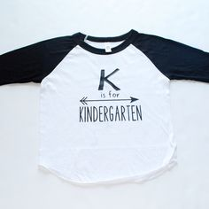 GARMENT DETAILS AND FIT This print is applied to our ever comfortable ¾ sleeve raglan. With a poly-cotton mix, this tee will be a favorite among your littles wardrobe with how soft it feels. Kindergarten Shirts, Kindergarten Rocks, Kindergarten Teachers, Preschool Shirts, Beginning Of School, First Day Of School, School Fun, Kindergarten Graduation, Teacher Outfits