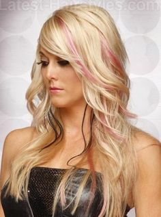 Curly blond hair with pink
