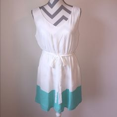 Colorblock White and Teal Dress This dress is beautiful!!  Only one large left!  (100% Polyester). Very retry and ready to wear!  Has a slip built in underneath.  Junior in fit. Dresses
