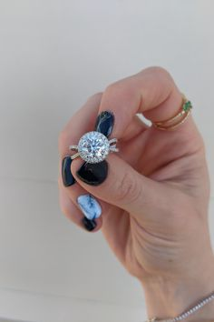 This 2.16 carat round diamond engagement ring features a diamond halo and twisted shank. Available at Diamonds Direct. #round #diamond #engagementring #twist #twisted #shank #diamondsdirect