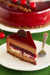 Chocolate cherry cake covered with a mirror coating.