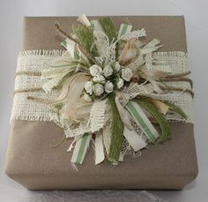 Rustic wrapping with burlap ribbon and brown paper.