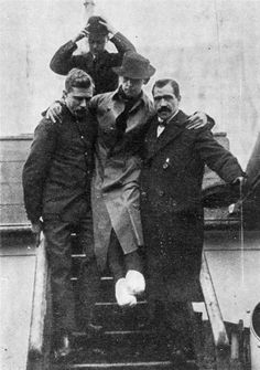 Rescuers help Titanic radio operator Harold Bride off the Carpathia. Bride's S.O.S. call alerted rescuers to the Titanic's sinking. He stayed at his post until the captain released him as the boat deck started taking on water, according to Encyclopedia Titanica. He was washed overboard and made his way onto an overturned boat, but his feet were badly frozen and crushed. From the Carpathia, Bride continued to send messages and names of those saved to land.