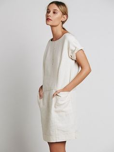 5113e3fb0f1 Shapeless linen dress featuring exposed seam detailing and large front  pockets. Cuffed short sleeves.