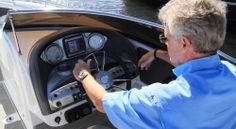 """Cruisers Yachts 258Z: The helm has a functional but uncluttered feel while still maintaining a high level of fit-and-finish. A Garmin GPS with a 4""""(10.16 cm) display is protected from the sun by a soft-touch vinyl brow stitched with UV resistant Gore Tenera thread."""