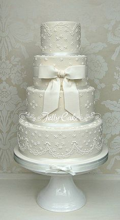 4 Tier Lace and Bow Wedding Cake | Flickr - Photo Sharing! Piped lace with a scalloped border finished with a sugar bow. www.jellycake.co.uk