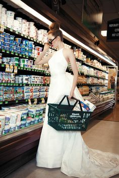 Bride in wedding dress at grocery store from Richmond Bride magazine fashion feature. Ivory satin gown with gathered trumpet train by Vera Wang, $5,000 at Bliss Bridal Consign-ment Boutique.