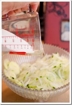 I don't even like cucumbers, but I love them like this!  Marinated Cucumber & Onions