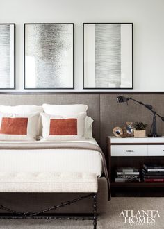 On display in the guest bedroom, a series of works by Jeremiah Johnson hang above a custom-designed upholstered headboard and bedside tables. // Residences at Mandarin Oriental, Atlanta, GA
