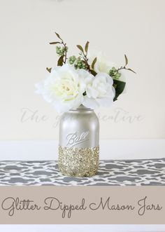 DIY Glitter Dipped Mason Jars - What a GREAT way to GLAM them up! It really adds a new level of beauty to a rustic decorated room!