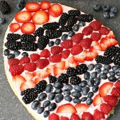 """Easter Egg Fruit Pizza is a festive sugar cookie fruit """"pizza"""" with strawberry cream cheese frosting topped with fresh berries. You can make it super simple with a sugar cookie mix or make it from Easter Snacks, Easter Appetizers, Easter Brunch, Easter Treats, Easter Recipes, Holiday Recipes, Easter Food, Easter Dinner, Appetizer Ideas"""